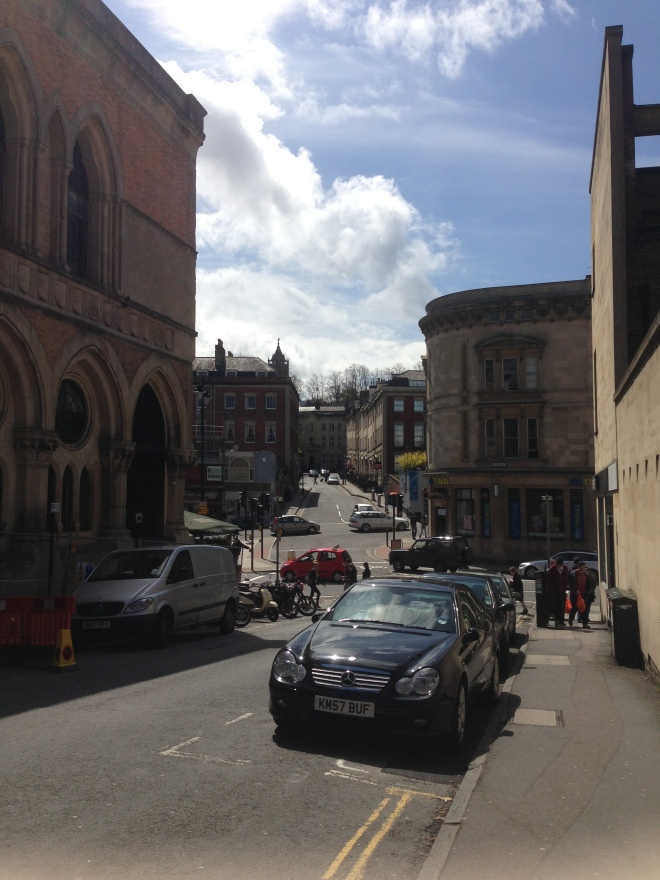 Bristol streets. It's busy like London, but the buildings are noticeably more of the old kind