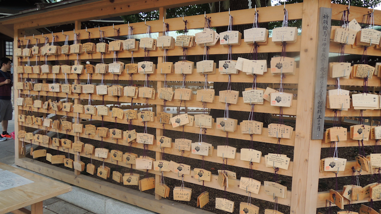 "Votive boards which you can purchase for 500 yen to write your wishes on it and hang them up. It was really entertaining to read them; there was one board that said ""I wish to be a millionaire before 26"" by someone from Spain which, honestly, isn't as bad as Dan Howell writing about Kanye West"